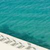 Corfu: Dive into crystal clear seawater at Marbella Corfu