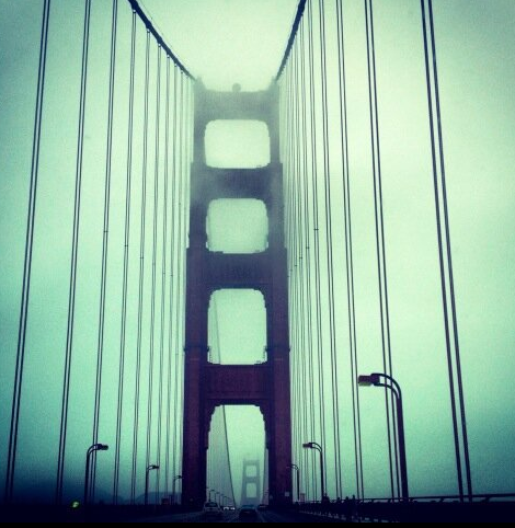 The Golden Gate Bridge covered in mist