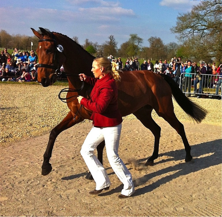 Zara Phillips wore white jeans with a burgendy jacket