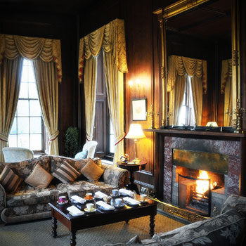 Guests can snuggle up by the fire in the lounge
